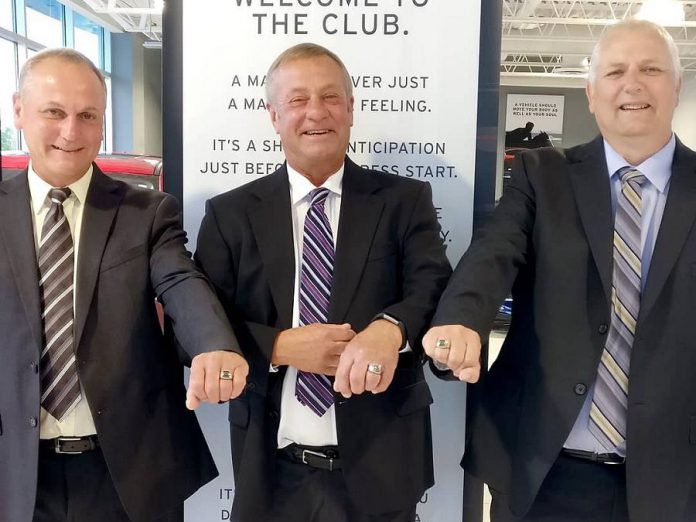 Brothers Ben, Terry, and Rob Angevaare display the Mazda rings they received when Angevaare Mazda was awarded the title of 2018 Mazda Dealer of Distinction. (Photo: Angevaare Mazda / Instagram)