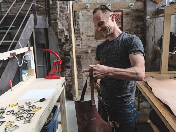 Jesse Bateson, owner and operator of Solid Leather, which produces stylish and durable handmade solid leather belts, was one of seven local entrepreneurs who received a grant under the first 2018 intake of Starter Company Plus, a provincially funded business development program delivered by Peterborough & the Kawarthas Business Advisory Centre. Applications are now open for the September 2018 intake for the program. (Photo: Samantha Moss)