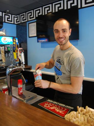 Giorgos Kallonakis, owner of the popular Port Hope resaturant Olympus Burger, makes a Pennywise Float. (Photo: April Potter / kawarthaNOW.com)