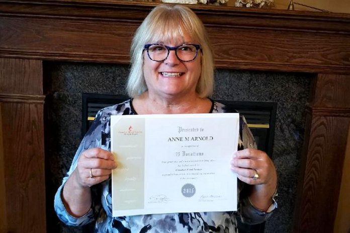 One of the ways the Women's Business Network of Peterborough is giving back to the community in 2018-19 is by organizing blood donor drives. Pictured is WBN member Anne Arnold with a certificate from Canadian Blood Services recognizing her 75 blood donations. (Photo: Anne Arnold)