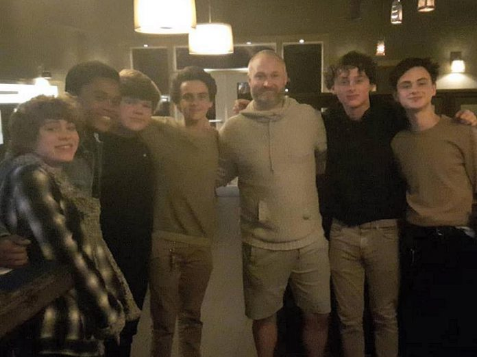 Kettle Drums owner Cam Green (third from right) with some of the cast from the 2017 IT film, which was partly shot in Port Hope in 2016. Filming on the IT sequel, where the young characters from the 2017 film are portrayed by adult actors, is wrapping up filming in Port Hope this month. (Photo: Cameron Green)