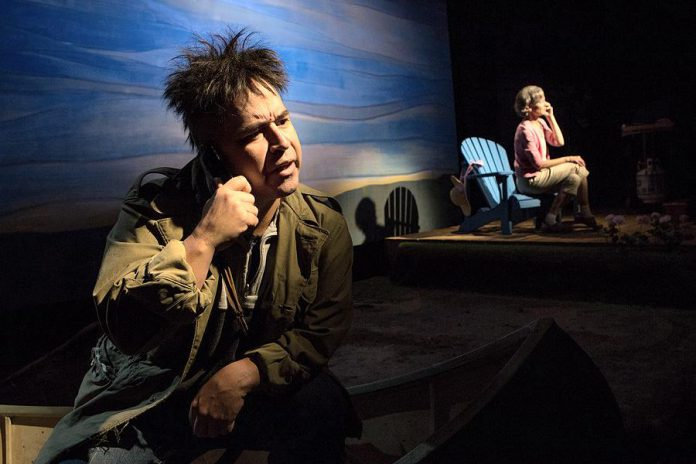 "Herbie Barnes as Arthur Copper and Tracey Hoyt as Maureen Poole in the original Tarragon Theatre production of ""Cottagers and Indians"", Drew Hayden Taylor's light-hearted exploration of the real-life conflict between cottagers objecting to the production of wild rice in Pigeon Lake by James Whetung of Curve Lake First Nation. Barnes will reprise his role, with Brooke Johnson taking on the role of Maureen, in the touring version of the play, which will be performed at Curve Lake First Nation, Bobcaygeon, and Peterborough in October and November. (Photo: Cylla von Tiedemann)"