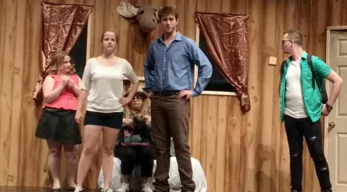 Five college students on spring break (Hillary Dumoulin as Shelly, Sophie Robinson as Linda, Meg O'Sullivan as Cheryl, Andrew Little as Ash, and Brandon Humphrey as Scott) stay in an old cabin in the woods, where they awaken demons. (Photo: Sam Tweedle / kawarthaNOW.com)
