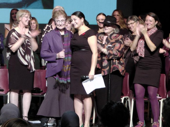 As several of the 54 women who received leadership awards applaud, Sister Ruth Hennessey accepts the Lifetime Achievement Award from Peterborough-Kawartha MP and Minister of Status of Women Maryam Monsef at the inaugural Peterborough-Kawartha Women's Leadership Awards, held on October 27, 2018 at Showplace Performance Centre in downtown Peterborough. (Photo: Bruce Head / kawarthaNOW.com)