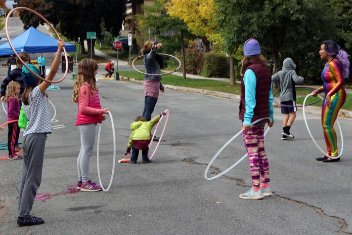 At two recent Pulse Pop-ups in Peterborough's East City, Sharleen from Boho Fab (far right) led attendees in hula hoop activities along with whimsical hoop performances for residents to enjoy. (Photo: Karen Halley)