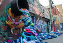 "It takes 2,650 litres of water to produce a single cotton t-shirt, and Canadians throw away more than 12 million tonnes of clothing and textiles every year, 95 per cent of which could be reused or recycled. Pictured is part of an interactive art installation about textile waste in Graffiti Alley of Toronto's Fashion District created by Value Village Thift Store for ""Textile Tuesday"" during Waste Reduction Week, which takes place until October 21st. (Photo: Value Village / Instagram)"
