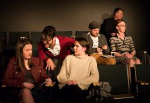 """In """"Appropriate Audience Behaviour"""", Ashley (Emma Meinhardt, front left) and Carol (Sam Weatherdon, front right) are two high school students trying to enjoy a performance of Hamlet despite the distractions created by fellow audience members including a patronizing Shakespeare snob (Kelsey Gordon Powell, front centre). Also pictured are Andrew Root, Sheila Carleton, and Nathan Govier. The production runs from November 29 to December 1, 2018 at The Theatre On King in downtown Peterborough. (Photo: Andy Carroll)"""