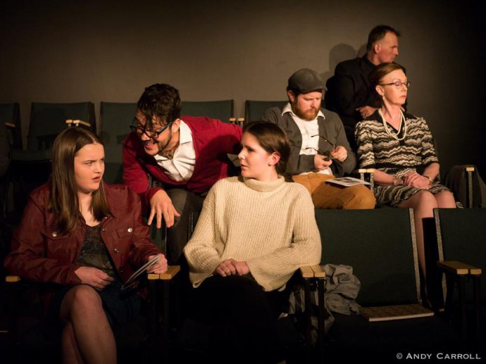 "In ""Appropriate Audience Behaviour"", Ashley (Emma Meinhardt, front left) and Carol (Sam Weatherdon, front right) are two high school students trying to enjoy a performance of Hamlet despite the distractions created by fellow audience members including a patronizing Shakespeare snob (Kelsey Gordon Powell, front centre). Also pictured are Andrew Root, Sheila Carleton, and Nathan Govier. The production runs from November 29 to December 1, 2018 at The Theatre On King in downtown Peterborough. (Photo: Andy Carroll)"