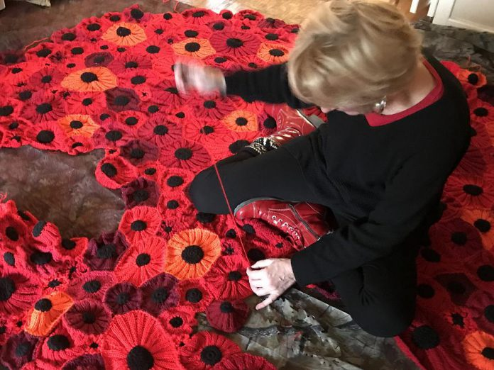 Hospice coordinator Heather Brough sews poppies together at the Hospice House for North Hastings in Bancroft. (Photo: Barb Shaw)