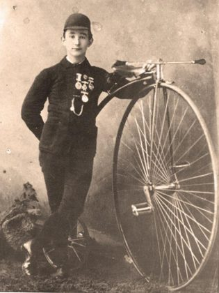 The Peterborough Cycling Club is one of the oldest cycling clubs in Canada. Pictured is member Alex Gibson with his high wheel bike and medals. (Photo courtesy of Lorne Shields via  The Bicycle Museum)