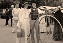 """Dr. Wilbert Willoughby Belch with his replica penny-farthing """"high wheel"""" bicycle in 1967 at Canada's centennial celebration in Jackson Park in Peterborough. You can see the replica bike as part of the The Bicycle Museum's pop-up exhibit at the Peterborough Public Library, which opens on December 3, 2018 and runs until January. (Photo courtesy of The Bicycle Museum)"""