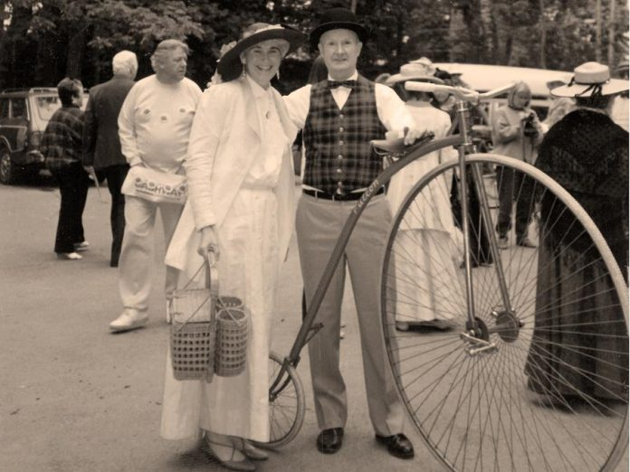 "Dr. Wilbert Willoughby Belch with his replica penny-farthing ""high wheel"" bicycle in 1967 at Canada's centennial celebration in Jackson Park in Peterborough. You can see the replica bike as part of the The Bicycle Museum's pop-up exhibit at the Peterborough Public Library, which opens on December 3, 2018 and runs until January. (Photo courtesy of The Bicycle Museum)"