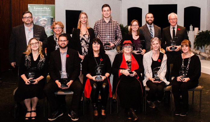 The recipients of the 2018 Kawartha Chamber of Commerce & Tourism 2018 Awards of Excellence, from back to front, left to right:  Jason Ross, The Regency of Lakefield; Susan Dunkley, Peterborough Humane Society; Alex Tindale, Peterborough Humane Society; Alex Gastle, Vetterview; Tracy Logan, Logan Tree Experts; Matt Logan, Logan Tree Experts; Ross Bletsoe, Lakefield Foodland; Laurie Siblock, Lang Pioneer Village Museum; Shawn Morey, Peterborough Humane Society; Cindy Windover, Windover Plumbing; Audrey Von Bogen, Shambhala Bed and Breakfast; Emily Wilkins, Adventure Outfitters; and Rachel Sloan, Trinkets and Treasures. (Photo:  Erin Caitlin Photography)
