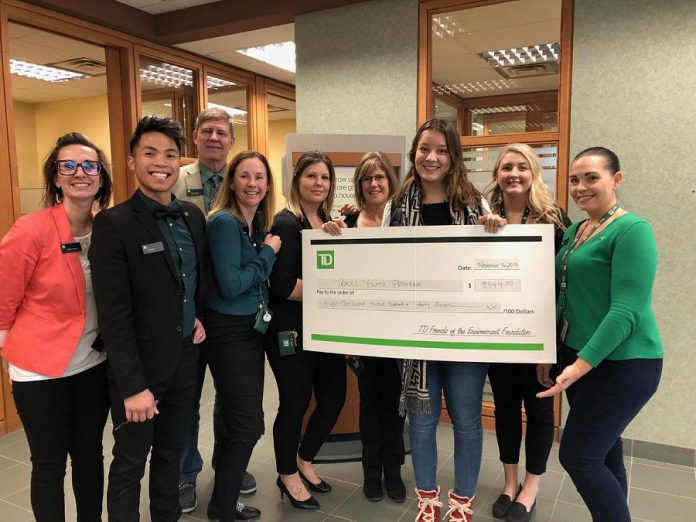 Staff at the Chemong branch of TD Canada Trust present a grant for $8,344 to the TRACKS Youth Program. (Photo courtesy of TD Canada Trust)