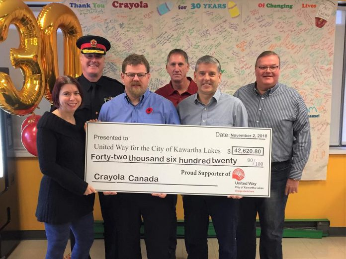 Crayola Canada, headquartered in Lindsay, has donated $42,620.80 to the United Way for the City of Kawartha Lakes, representing the proceeds from this year's annual Crayola Sale. Pictured are (left to right, back to front) 2018-2019 United Way Campaign Chair Police Chief Mark Mitchell, Crayola Canada HR Mike Soehner, Crayola Canada Finance John DeBois, United Way CKL Community Investment Coordinator Shantal Ingram, United Way CKL Board President Duncan Gallacher, and Crayola Canada General Manager Paul Murphy. (Photo courtesy of United Way CKL)