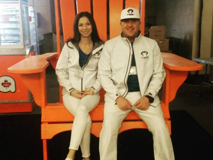 "Jeremy Hannan and his wife at the Toronto boat show. He has been displaying his Cobramask at trade shows and other events for the past two years. He says the exposure from being on Dragons' Den is a ""huge perk"".  (Photo courtesy of Jeremy Hannan)"