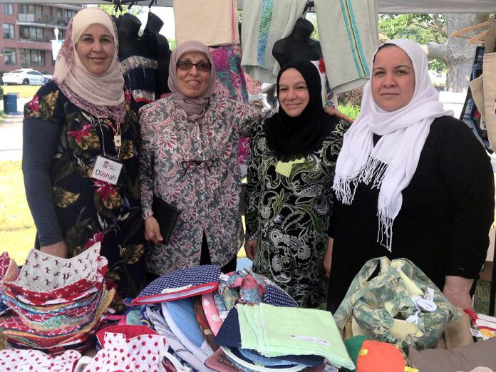 Members of the Sewing Collective (Dilsha Ahmed, instructor Zakia Al-Haddad, Khadija Derde, and Emine Derde) create a variety of beautifully hand sewn items such as tea cozies, aprons, reusable fabric sandwich bags, casserole carriers, and more. (Photo: Reem Ali)