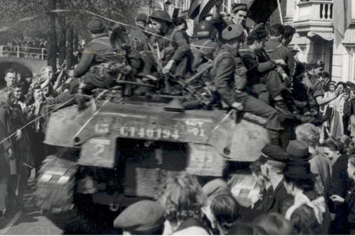 Members of the Stormont, Dundas and Glengarry Highlanders were greeted wildly by Dutch residents following their country's liberation from Nazi rule in May 1945.  (Supplied photo)