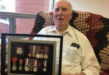 Fairhaven resident Joe Sullivan, 98, displays a montage of medals related to his war service. Sullivan was one of the Canadian assault troops in the 3rd Canadian Division of the Canadian Army who landed on Juno Beach in Normandy during the Allied invasion of German-occupied France on D-Day, June 6, 1944, which led to the liberation of Europe from Nazi occupation on May 8, 1945. In 2015, Joseph Sullivan was awarded the French National Order of the Legion of Honour (bottom left) in recognition of his war service. (Photo: Paul Rellinger / kawarthaNOW.com)