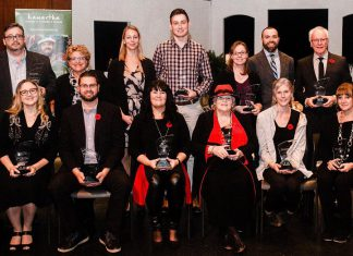 The recepients of the 2018 Awards of Excellence (back to front, left to right): Jason Ross, The Regency of Lakefield; Susan Dunkley, Peterborough Humane Society; Alex Tindale, Peterborough Humane Society; Alex Gastle, Vetterview; Tracy Logan, Logan Tree Experts; Matt Logan, Logan Tree Experts; Ross Bletsoe, Lakefield Foodland; Laurie Siblock, Lang Pioneer Village Museum; Shawn Morey, Peterborough Humane Society; Cindy Windover, Windover Plumbing; Audrey Von Bogen, Shambhala Bed and Breakfast; Emily Wilkins, Adventure Outfitters; Rachel Sloan, Trinkets & Treasures. (Photo: Erin Caitlin Photography)