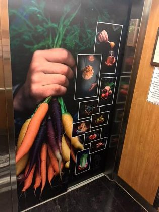 Promotional wrap for the market inside the elevator from the underground parking in Peterborough Square. (Photo: Peterborough Regional Farmers' Market / Facebook)