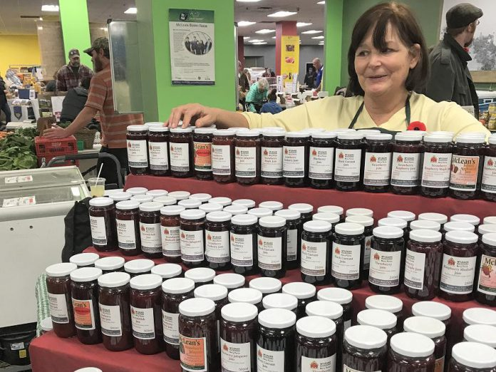 Cindy Leahy shows off the jams and jellies produced by McLean Berry Farm. (Photo: Barb Shaw / kawarthaNOW.com)
