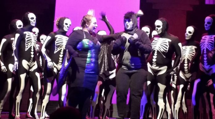 """Mallory MacDonald as the Dragon and Lindsay Barr as Donkey perform the showstopping number """"Donkey Pot Pie"""" with a horde of dancing skeletons. (Photo: Sam Tweedle / kawarthaNOW.com)"""