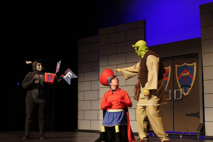 Lindsay Barr as Donkey, Taylor Beatty as Lord Farquuad, and Rowan Lamoureaux as Shrek. (Photo: Nate Axcell)