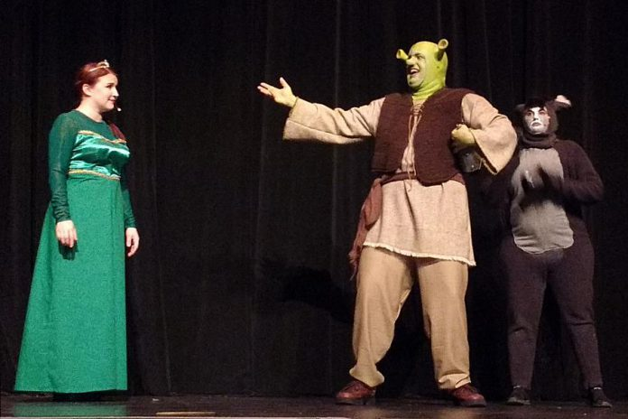 """The unlikely trio of """"Shrek: The Musical"""": Elizabeth Moody as Princess Fiona, Rowan Lamoureaux as Shrek, and Lindsay Barr as Donkey. The St. James Players production of the Tony-nominated musical runs from November 8 to 17 at Showplace Performance Centre in downtown Peterborough. (Photo: Sam Tweedle / kawarthaNOW.com)"""