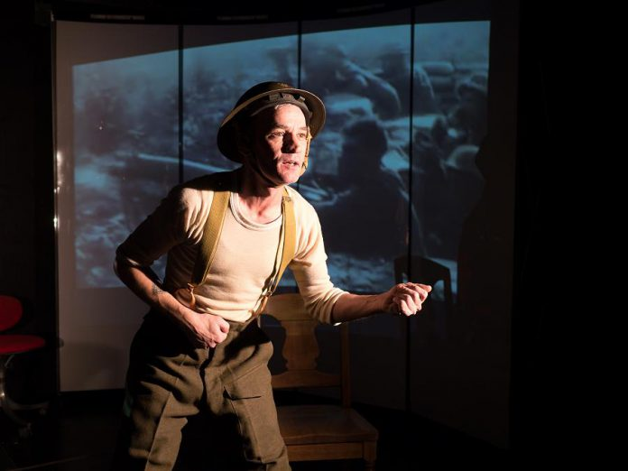 "Fleshy Thud's Ryan Kerr performs in his new play ""Unexploded Ordnance"", co-created with and directed by Kate Story, which premieres from November 8 to 11, 2018 at The Theatre On King in downtown Peterborough. The play will also tour four area high schools as part of their Remembrance Day programming. (Photo: Andy Carroll for Public Energy)"
