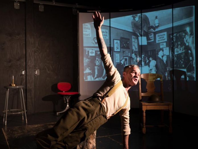 Ryan Kerr merges history and storytelling in a captivating hour-long performance that also features movement, music, projection, and soundscapes. (Photo: Andy Carroll for Public Energy)