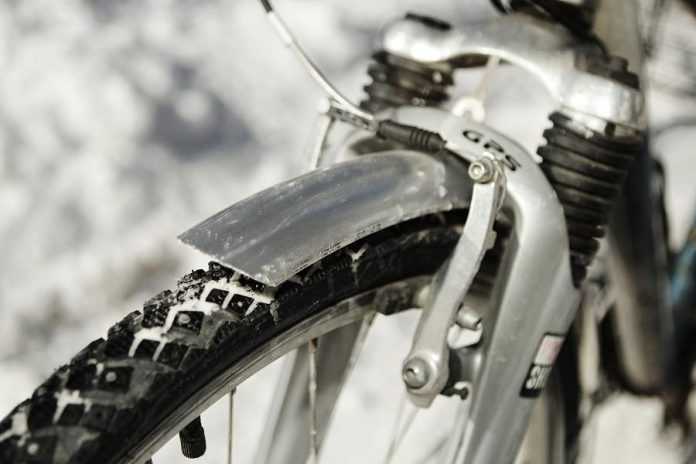 Studded tires will help you ride in the snow and fenders will help protect your clothes and body from the spray off your tires. (Photo: EnviroCentre)