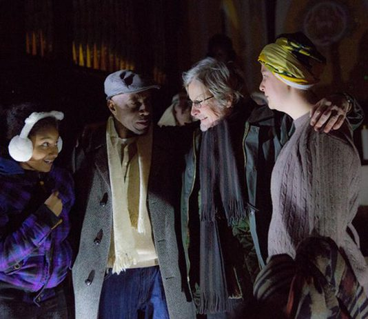 """In """"The Other: A Strange Christmas Tale"""", Leanne (Jalen Brink, left) is the daughter of Bill (Danny Waugh, second from left) and Judy (Naomi Duvall, right), who is estranged from her bigoted father Ebbie Krank (Robert Winslow, second from right). When a mysterious woman arrives in the Village of Millbrook, Ebbie is taken on a journey through his past, present, and future to understand the causes of his racism. (Photo: Wayne Eardley, Brookside Studio)"""