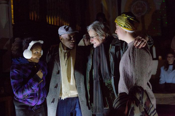 "In ""The Other: A Strange Christmas Tale"", Leanne (Jalen Brink, left) is the daughter of Bill (Danny Waugh, second from left) and Judy (Naomi Duvall, right), who is estranged from her bigoted father Ebbie Krank (Robert Winslow, second from right). When a mysterious woman arrives in the Village of Millbrook, Ebbie is taken on a journey through his past, present, and future to understand the causes of his racism. (Photo: Wayne Eardley, Brookside Studio)"