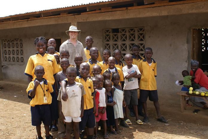 Peter Brown, Theresa Foley's parter in Humanwave.com, with students from a school in Liberia, West Africa. Humanwave.com has been sponsoring children at the school since 2007, and is currently sponsoring 13 students.  (Supplied photo)