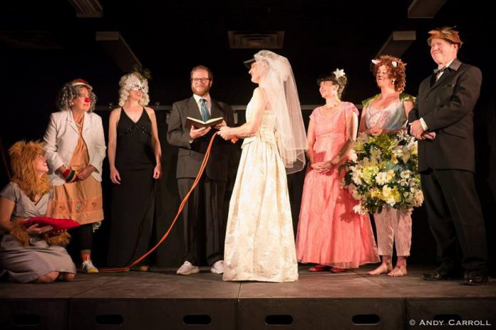 Ryan Kerr (in the wedding dress) demonstrates his commitment to the new The Theatre of King at a ceremony officiated by performer and writer Andrew Root. (Photo: Andy Carroll)