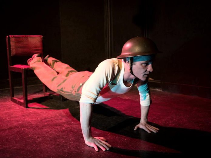 "Fleshy Thud's Ryan Kerr performs in his new play ""Unexploded Ordnance"" at The Theatre On King in downtown Peterborough. (Photo: Andy Carroll for Public Energy)"