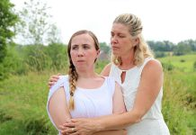 """Grace Thompson as 15-year-old Serena with Cynthia Ashperger as her mom Ramona in Judith Thompson's play """"Who Killed Snow White?"""" at the Winslow Farm in Millbrook. The controversial departure from 4th Line Theatre's usual historical fare was one of the best theatrical productions of 2018 according to kawarthaNOW's theatre reviewer Sam Tweedle. (Photo: Heather Doughty / kawarthaNOW.com)"""