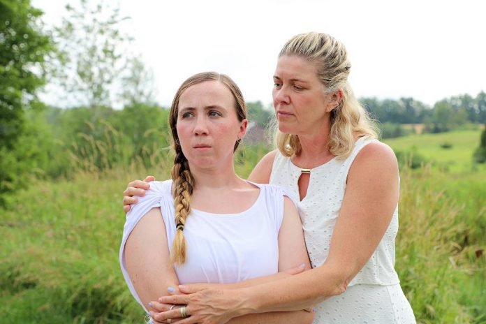 "Grace Thompson as 15-year-old Serena with Cynthia Ashperger as her mom Ramona in Judith Thompson's play ""Who Killed Snow White?"" at the Winslow Farm in Millbrook. The controversial departure from 4th Line Theatre's usual historical fare was one of the best theatrical productions of 2018 according to kawarthaNOW's theatre reviewer Sam Tweedle. (Photo: Heather Doughty / kawarthaNOW.com)"