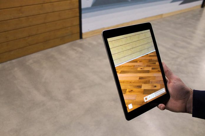 An augmented reality mobile app developed by Kavtek helps customers of Monaghan Lumber in Cavan choose new flooring for their home. (Supplied photo)