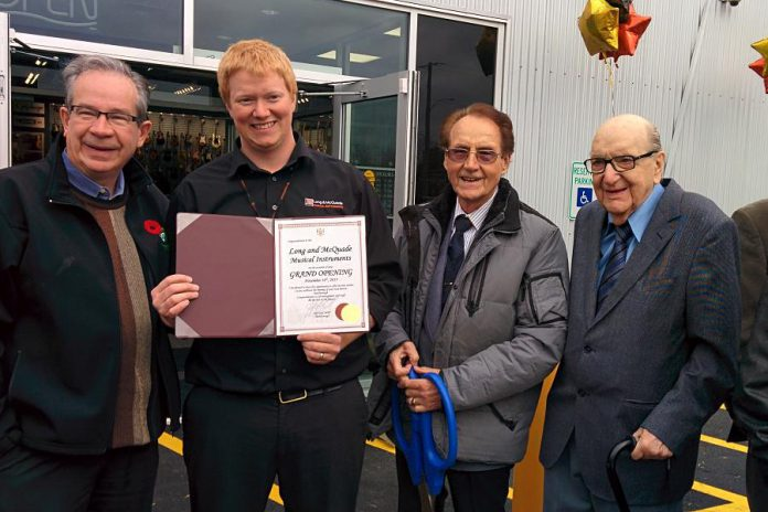 The late Bud Monahan (second from right) at the November 2015 grand opening of Long & McQuade, which purchased  Bud's Music Centre. Monahan operated the business for 23 years, until he sold it in 1991 to his son Robert and his son-in-law Rob Branscombe. (Photo: Bruce Head / kawarthaNOW.com)
