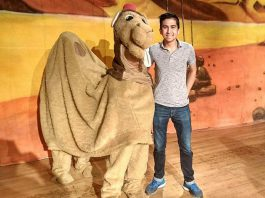 """Alice the Camel with Toronto actor Armon Ghaeinizadeh, who plays Ali Baba, at a reherasal of """"Ali Baba and the Forty Thieves"""", Globus Theatre's family panto version of the classic Middle Eastern folk tale. Written by Sarah Quick and also starring Sarah, James Barrett, Siobhan O'Malley, and a rotating cast of 50 children, the play runs from December 7 to 16, 2018 at the Lakeview Arts Barn in Bobcaygeon. (Photo: Sam Tweedle / kawarthaNOW.com)"""