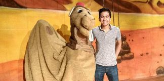 "Alice the Camel with Toronto actor Armon Ghaeinizadeh, who plays Ali Baba, at a reherasal of ""Ali Baba and the Forty Thieves"", Globus Theatre's family panto version of the classic Middle Eastern folk tale. Written by Sarah Quick and also starring Sarah, James Barrett, Siobhan O'Malley, and a rotating cast of 50 children, the play runs from December 7 to 16, 2018 at the Lakeview Arts Barn in Bobcaygeon. (Photo: Sam Tweedle / kawarthaNOW.com)"
