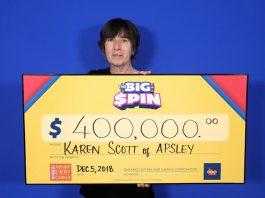 Karen Scott of Apsley with her $400,000 prize. (Photo: OLG)