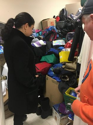 Carol's Place volunteer Dan Hennessey shows Peterborough-Kawartha MP Maryam Monsef the backpacks stocked with essential items that the agency is collecting this holiday season for marginalized people.  (Photo: Paul Rellinger / kawarthaNOW.com)