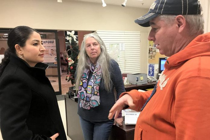Peterborough-Kawartha MP Maryam Monsef dropped by Carol's Place in Peterborough Square on Tuesday morning (December 18), chatting with volunteers Susan Gontier and Dan Hennessey as well as a few clients of the drop-in centre. (Photo: Paul Rellinger / kawarthaNOW.com)