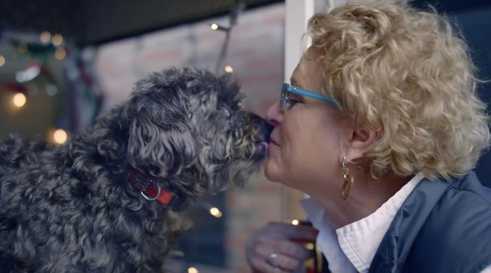 The Peterborough Humane Society's Susan Dunkley gets a kiss from her dog Zoey.  (Screenshot)