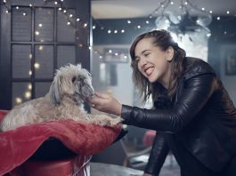 """Serena Ryder's new video for the title track from her new record """"Christmas Kisses"""" supports the Ontario SPCA by featuring more than 20 dogs, with some dressed in festive outfits and some giving kisses to their humans. Several dogs and their owners from the Kawarthas appear in the video. (Screenshot)"""