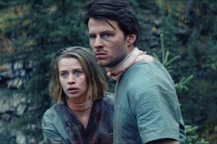 "Thomas Cocquerel and Camille Stopps in the survival horror film ""Alive"", which screens at the Market Hall on March 1, 2019. (Photo courtesy of Blood in the Snow)"