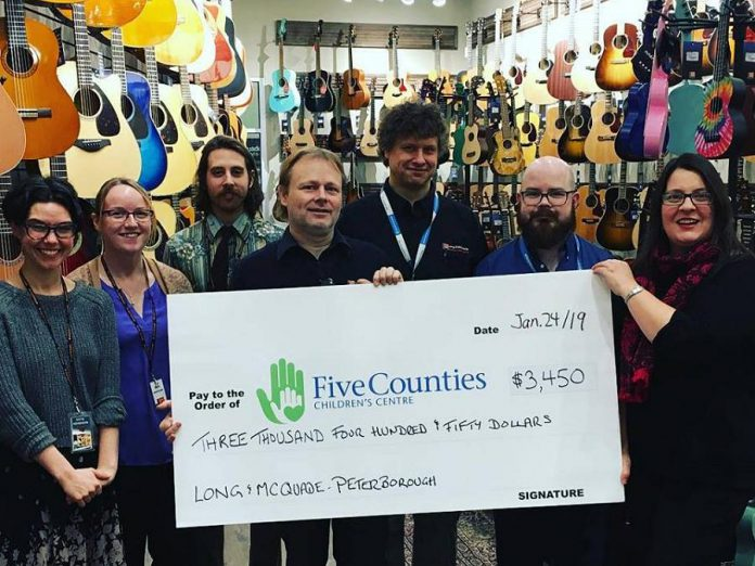 Staff at Long & McQuade Peterborough with their donation to Five Counties Children's Centre. (Photo: Long & McQuade Peterborough / Facebook)
